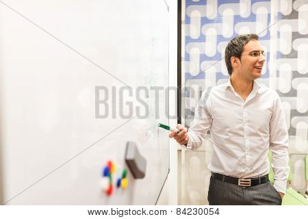 Businessman Discussing Plans At The White Board
