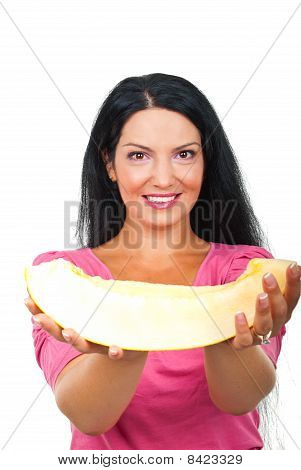 Attractive Woman Giving A Slice Of Melon