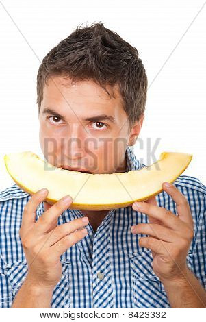 Man Eating Cantaloupe