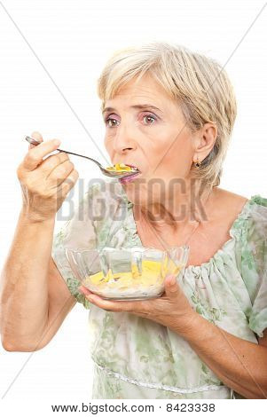 Senior Woman Eating Cereals