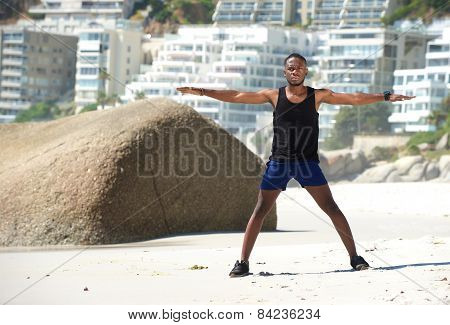 Sports Man Exercising With Arms Spread Open