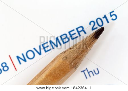 The Tip Of A Pencil Point To The Year 2015 Text.