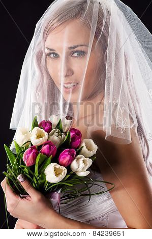 happy bride with a bouquet of tulips