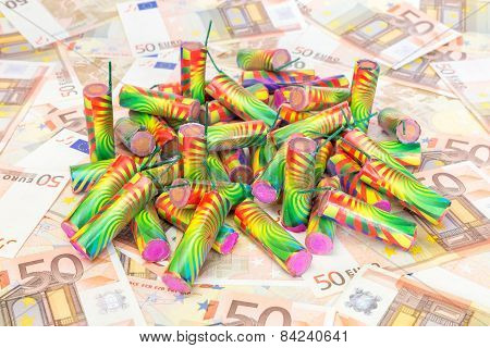 Heap of colorful firework on spread euro notes