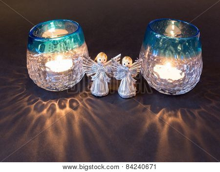 Two little angels and tea lights for christmas