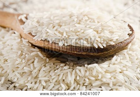 Raw Basmati Rice In A  Wooden  Spoon