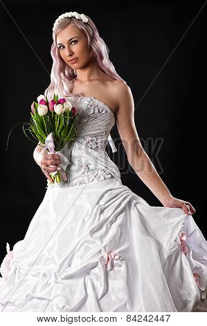 bride with a wedding bouquet of tulips