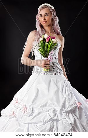 charming bride with a wedding bouquet of tulips