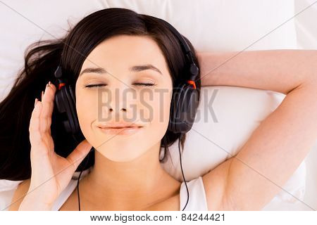 Woman Enjoying Music.