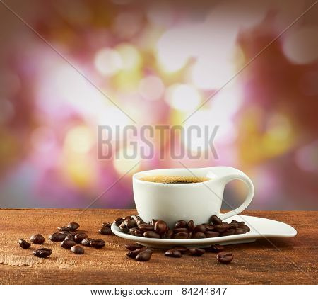 Warm Cup Of Coffee On Blur Background