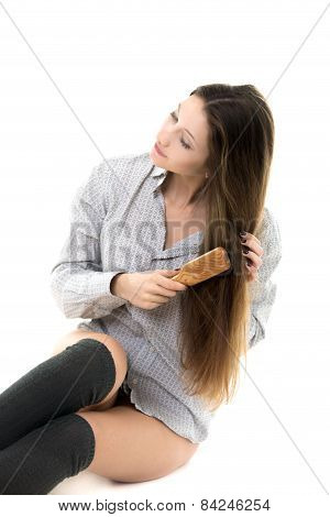 Gorgeous Model Combing Her Hair In Shirt And Spats