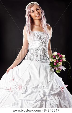 smiling bride with a wedding bouquet of tulips
