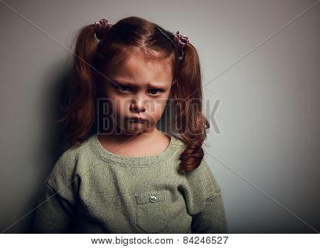 Sad Kid Girl With Long Hair. Closeup Vintage Portrait