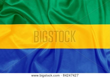 Gabon - Waving national flag on silk texture