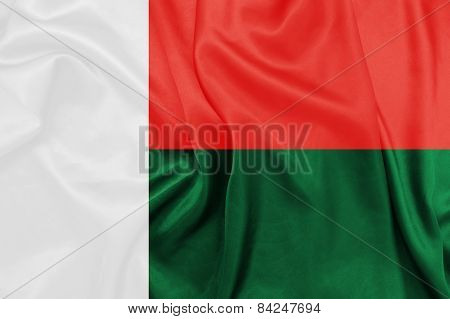 Madagascar - Waving national flag on silk texture