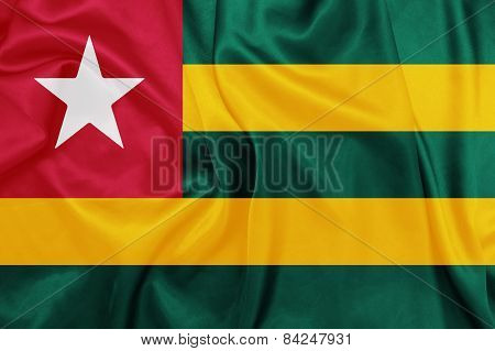 Togo - Waving national flag on silk texture
