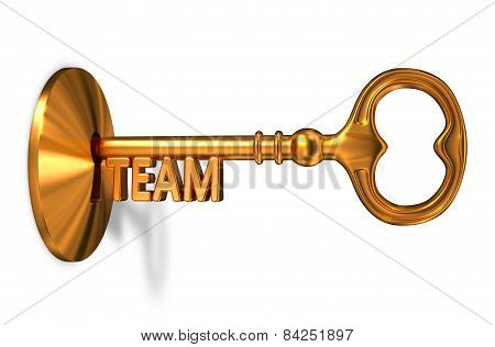 Team - Golden Key is Inserted into the Keyhole.