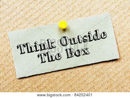 Recycled Paper Note Pinned On Cork Board.think Outside The Box Message. Concept Image