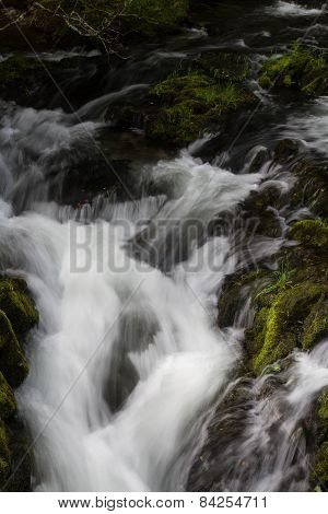 Cascade Of Small Waterfall Over Mossy Rocks, Long Exposure.