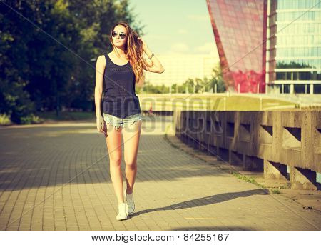 Trendy Hipster Girl Walking in the Park