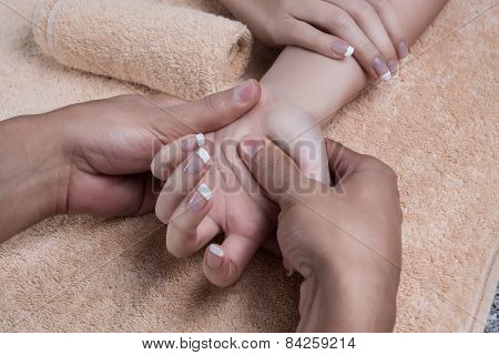 Massage after manicure.