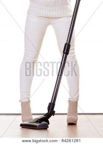 Female Legs With Vacuum Cleaner Isolated