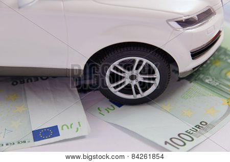 Detail of a car on 100 euro notes