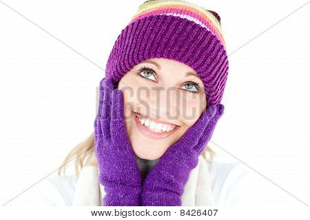 Cheerful Young Woman With Cap And Gloves In The Winter