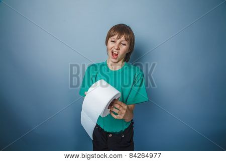 boy teenager European appearance in green t-shirt holding a toil