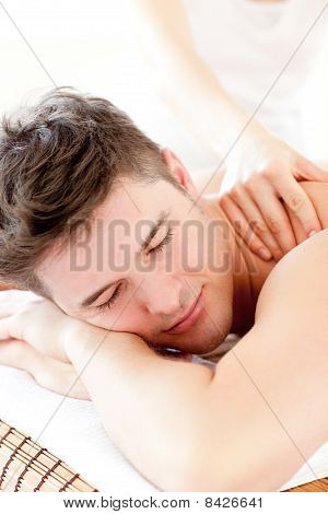 Attractive Young Man Enjoying A Back Massage