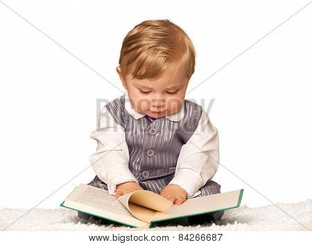 Baby boy reading a book