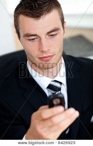 Concentrated Young Businessman Sending A Text