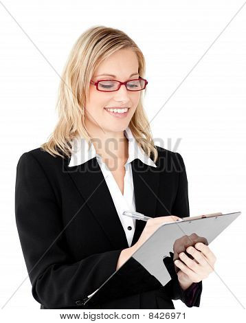 Concentrated Businesswoman Writing On A Clipboard