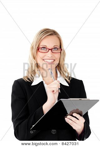 Thoughtful Businesswoman Holding A Clipboard