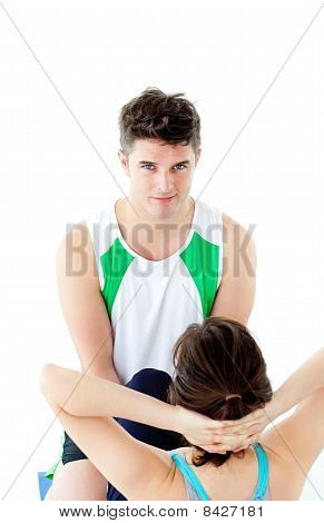 Male Therapist Doing Fitness Exercises With A Woman