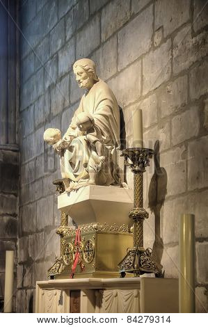 The Sculpture Of The Saint In The Cathedral Of Notre Dame