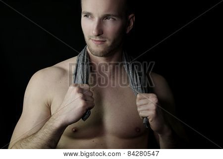 handsome muscular man holding a towel