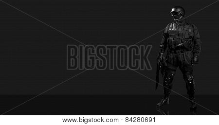 Soldiers in a black protective form on a gray background.