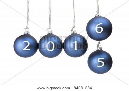 Five blue christmas baubles symbolizing old and new year