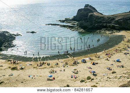 Tourists Enjoy Papagayo Beach On A Sunny Spring Day