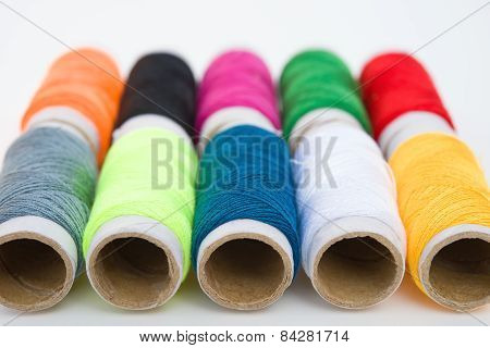 Colorful Bobbins On White Background