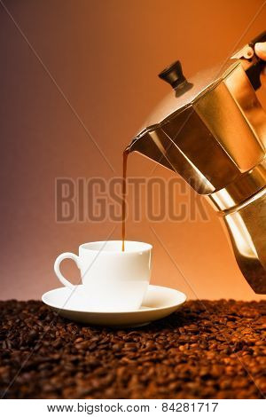 pouring fresh coffee into coffee cup