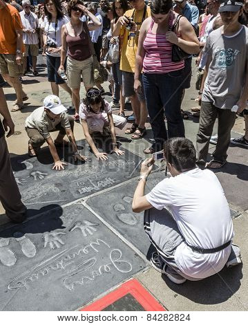 People Admire The Hand And Footprints Of Harry Potter