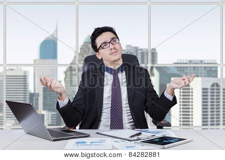Baffled Businessman Finding An Idea