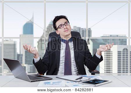 Baffled Businessman Finding An Idea