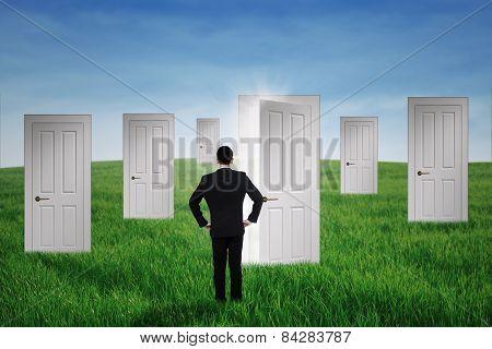 Businessman Walking To Opportunity Doors
