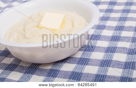 White Bowl Of White Grits Wtih Butter Close
