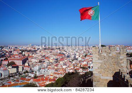 Lisbon spring skyline with Portugal flag