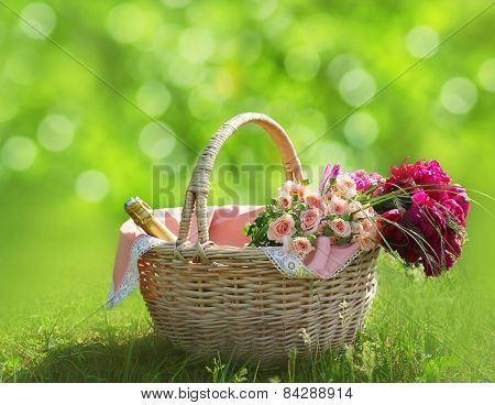 Romance, Love And Valentine's Day Concept - Sweet Basket With Bouquet Of Flowers On The Grass. Sprin