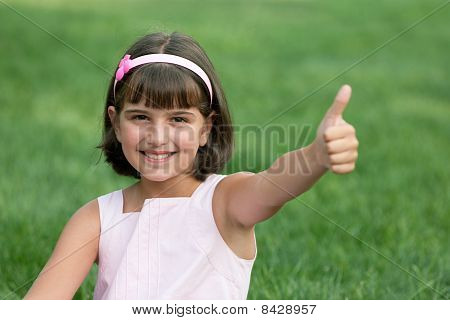 Happy Girl Holding Thumb Up